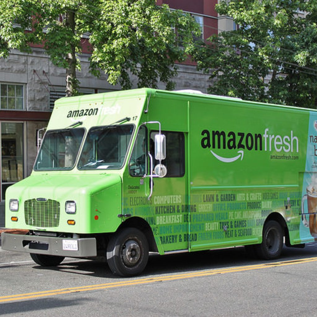 A green Amazon Fresh delivery truck