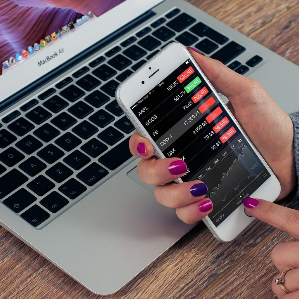 A woman looking over a Stock Market App