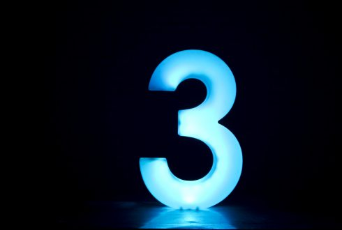 the number 3 in blue with a black background